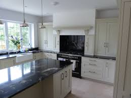 Granite Kitchen Benchtops Cosmic Black Granite Benchtops With White Cupboard Fronts