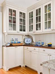 cream white kitchen cabinets with warm wood countertops