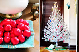 Living room: Silk red ball ornaments in hubs's grandmother's mid-century  dish. Aluminum Christmas tree (thrifted this summer!) with my grandmother's  glass ...