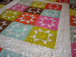 Reach for the Stars With Star Block Quilts & White Quilt with Multicolor Star Blocks Adamdwight.com