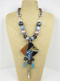 large ethnic necklace with shell laminated pendant