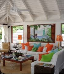 the tropical accents can save learn more at centsationalgirlcom tropical living roomstropical bedroomcoastal beach house living room tropical family room