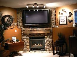 corner fireplace with tv above over fireplace ideas fireplace charming stone fireplace design ideas indoor plant corner electric fireplace with tv above