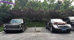 2018 maybach 62. plain 2018 a hongqi l5 sedan and a maybach 62 dressed as wedding car seen on the  parking lot of hotel in great city shanghai with 2018 maybach t
