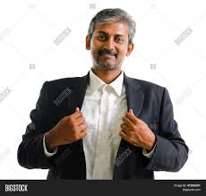 good looking asian indian business man with business suit smiling isolated on white background