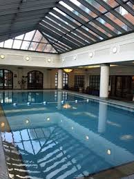 indoor gym pool. Belmond Charleston Place: The Indoor Pool And Atrium. Entrance To Gym Is S