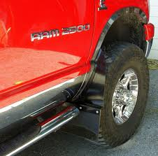 show me your mud flaps on lifted trucks 06 dodge front lifted