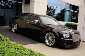 this 300 is the one that made me want to remove em but he has chrome door handles and the chrome on the front per to even it out