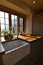 Traditional country kitchens Cottage Kitchen Traditional Country Kitchen Sink Hunt Bespoke Kitchens Country Living Kitchens Hunt Bespoke Kitchens Interiors