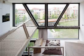 berlin townhouse by x th architecture uncube the top floor houses the kitchen and offers a spectacular view down into the house and