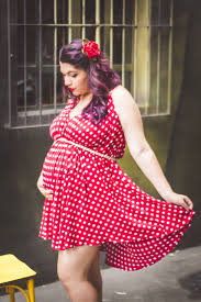 stock photos of pregnancy acirc middot pexels w in red and white polka dots mini dress holding her stomach