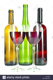 Bright colorful wine bottles and glass