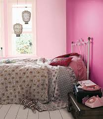 stylish las bedroom decor ideas with pink painted wall and grey patterned bedding sets also white iron bed frame plus antique hanging lantern