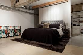 loft bedroom with brown duvet cover and brown rug