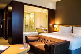 king premier room with open bathroom concept at js luwansa hotel and convention center