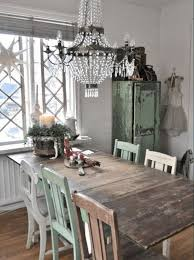 A Rustic Chic Dining Room With Reclaimed Wood Table And Vintage Crystal  Chandelier
