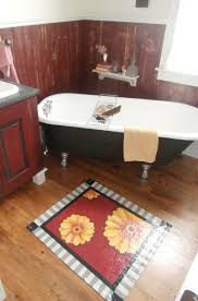 a smaller floorcloth works as an accent piece in esposito s bathroom by molly macmillan