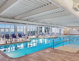 Indoor pool and hot tub Heated Indoor Swimming Pool And Hot Tub Ponchos Pond Hotel Amenities Luxury Ogunquit Me Hotel Cliff House Resort