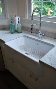 mesmerizing white farmhouse sink and wire floor and granite kitchen countertop also air supply spray faucet