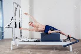pilates reformer workout exercises man at gym indoor stock photo 40299522