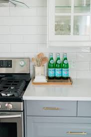 a gray and white budget friendly kitchen makeover using ikea cabinetry marble like quartz countertops