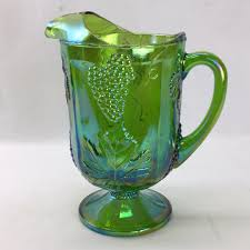 green carnival glass water pitcher with gs and leaf patter
