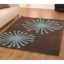 infinite starburst chocolate teal rug