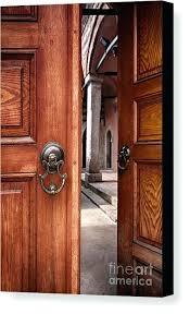 half open door door canvas print featuring the photograph half open doors by open door ossining
