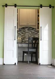 hidden home office. sliding barn doors reveal a hidden home office. | villagehomestores.com office