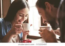drinking coffee images. Fine Images Happy Young Couple Is Drinking Coffee And Smiling While Sitting At The Cafe On Drinking Coffee Images R