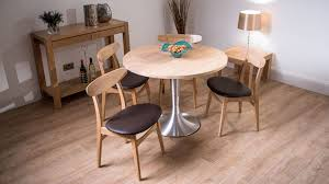 4 seater round dining table and brown dining chairs