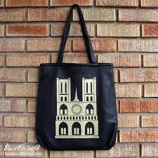 in memory of the notre dame cathedral this tote bag is paris coture in gold glittery