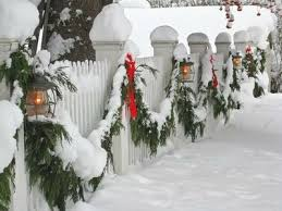 White picket fence, decorated for Christmas! This looks like a Norman  Rockwell scene!
