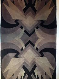 authentic rare art deco geometric handmade wool rug with off white edge colors are