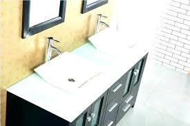absolute black granite countertops bathroom white cabinets with impala bathrooms