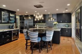 Contemporary Kitchen With Dark Cabinetry, White Quartz Counter, Porcelain  Tile Backsplash, Light Wood