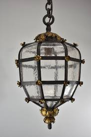 antique brass wrought iron open cage frame bent
