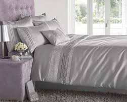 image of silver and gray twin quilt