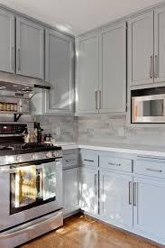 gray shaker kitchen cabinets with engineered white quartz countertops