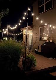 How To Hang Outdoor String Lights Amazing This Hack For Hanging Outdoor String Lights Will Make Your Summer In