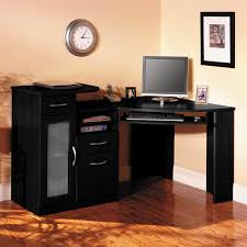 l shaped black wooden computer desk designs for home with closed cabinet and two drawers over laminate floor also clock and black wooden framed picture on