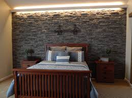 bedroom accent wall created with stacked stone textured panels