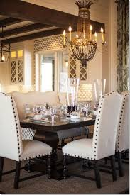 dining table parson chairs interior: dark rustic table lightly colored parsons chairs with nail heads dramatic chandelier
