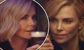 Bud Light Platinum Commercial Actress Charlize Theron Smolders As She Beats Rowdy Barflies At Pool