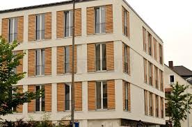 student house in marburg germany skirpus outdoor wooden sliding shutters larch wood louvers