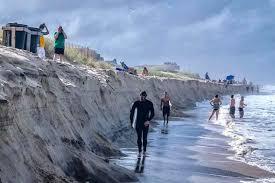King Tide Surf Carve Cliff At Nags Head Beach Coastal