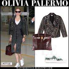 olivia palermo in black studded leather rebecca minkoff jacket black striped dress and white sneakers