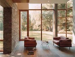 bright living room with natural stone wall
