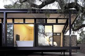 house with steel frame and glass wall
