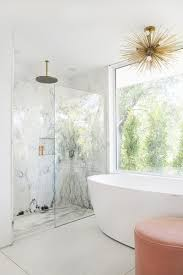 the marble continues into the shower while a freestanding tub is set up to take